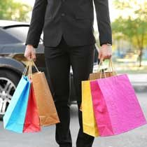 limo chauffeur holding shopping bags